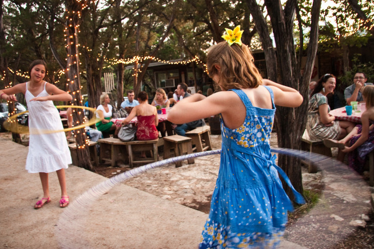Girl holla hooping at Wimberley, Texas Wedding